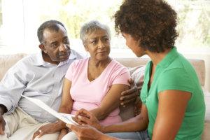 caregiver talkign to senior couple