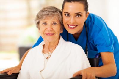 caregiver hugging senior