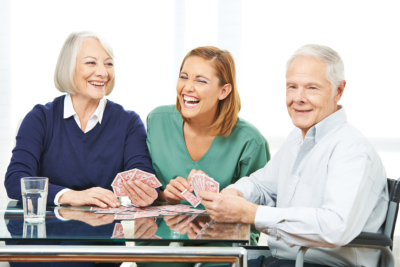 senior couple with their caregiver talking