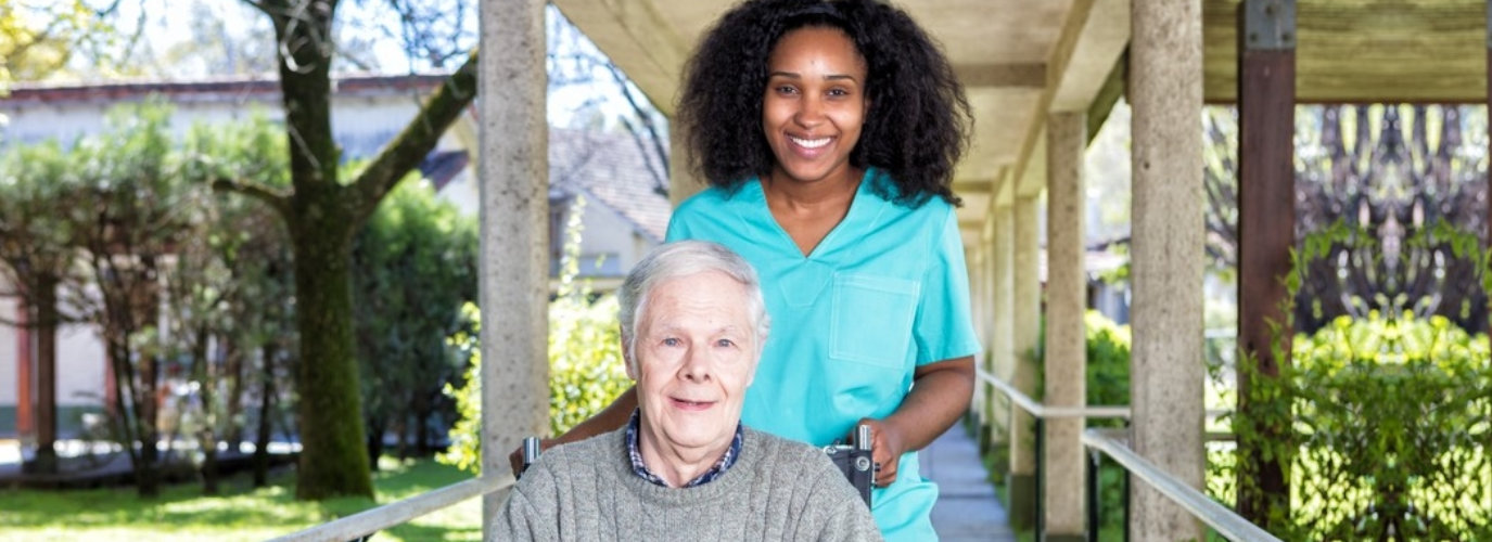 senior woman and a caregiver outside senior home